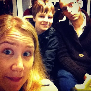 Three silly people on the bus to the city!